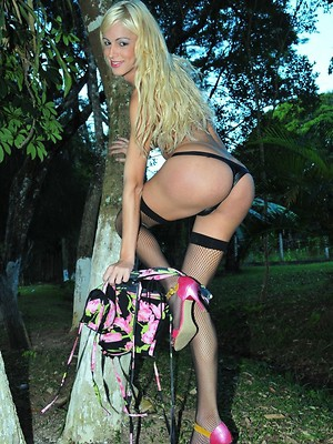 Sexy blonde tranny stripping in the forest