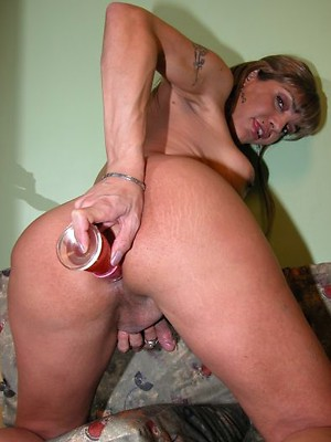 Blonde shemale from Argentina Ingrid playing with dildo insertions in her open ass