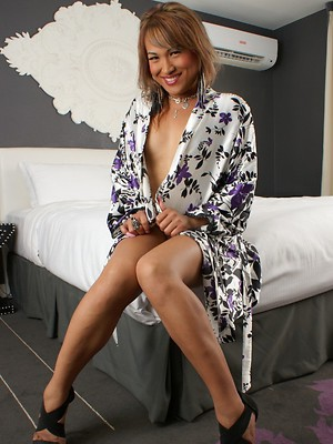 Sweet transsexual Lana stripping on the bed